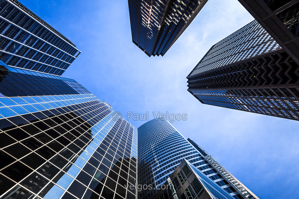 Photo of Chicago skyscraper office buildings looking upward toward the sky.