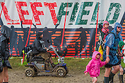 The rain falls again but everyone including the disabled manage to struggle on. And eventually the sun returns. The 2014 Glastonbury Festival, Worthy Farm, Glastonbury. 28 June 2013.  Guy Bell, 07771 786236, guy@gbphotos.com