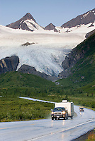 Richardson Highway Alaska winding its way up to Thompson Pass. In the background is the Worthington Glacier.