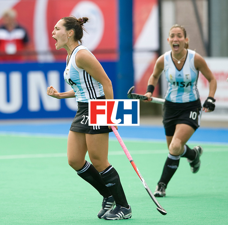 Argentina's Noel Barrioneuevo (27) celebrates after scoring the 4th goal during their Women's Champions Trophy Final at Highfields, Beeston, Nottingham, 18th July 2010.