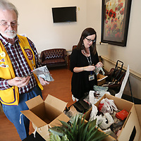 Adam Robison | BUY AT PHOTOS.DJOURNAL.COM<br /> Jim Bush, Tupelo Lions Club president, sorts through donated glasses with Cheri Nipp, a low vision specialist at The Retina Center in Tupelo. Vision issues at home and abroad are a major focus for the Lions Club, in addition to the glasses drive, they assist individuals with vision related treatment and assistance.