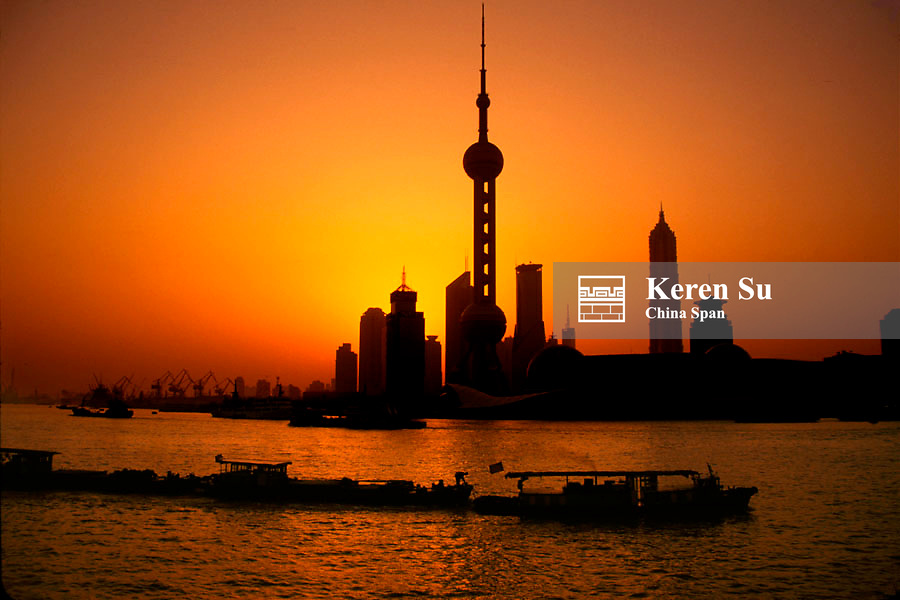 View of Oriental Pearl TV Tower and highrises in Pudong by Huangpu River under sunrise, Shanghai, China