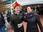28 NOVEMBER 2019 - DES MOINES, IOWA: US Senator KAMALA HARRIS (D-CA) talks to a person wearing a turkey hat in the finish area of the Turkey Trot. The Turkey Trot is an annual Des Moines Thanksgiving Day 5 mile fun run. Sen. Harris greeted runners in the finish area and handed out cookies. She is running to be the Democratic nominee for the US Presidency in 2020. Iowa hosts the first selection event of the presidential election season. The Iowa caucuses are February 3, 2020.              PHOTO BY JACK KURTZ