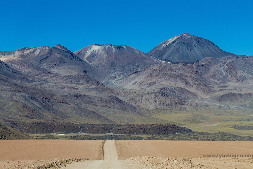Gravel road in Andean landscape. Location: Between San Pedro de Atacama and El Tatio geysir field, Atacama, north Chile