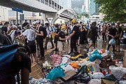 Protesters hand out masks, water, and goggles in front of the Central Government Offices, during a protest against a proposed extradition law in Hong Kong, SAR China, on Wednesday, June 12, 2019. Hong Kong's legislative chief postponed the debate on legislation that would allow extraditions to China after thousands of protesters converged outside the chamber demanding the government to withdraw the bill. Photo by Suzanne Lee/PANOS
