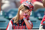 ANAHEIM, CA - MAY 06:  A young fan looks on while watching the Los Angeles Angels of Anaheim game against the Toronto Blue Jays on Sunday, May 6, 2012 at Angel Stadium in Anaheim, California. The Angels won the game 4-3. (Photo by Paul Spinelli/MLB Photos via Getty Images)