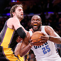 31 January 2014: Charlotte Bobcats center Al Jefferson (25) drives past Los Angeles Lakers center Pau Gasol (16) during the Charlotte Bobcats 110-100 victory over the Los Angeles Lakers at the Staples Center, Los Angeles, California, USA.