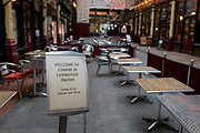 As the Coronavirus pandemic spreads across the UK, businesses and entertainment venues not already closed with the threat of job losses, struggle to stay open with growing rumours of a lockdown and travel restrictions around the capital. As Londoners work from home, tables remain empty in Leadenhall Market, a normally favourite lunchtime haunt for financial workers in the City of London, on 19th March 2020, in London, England.