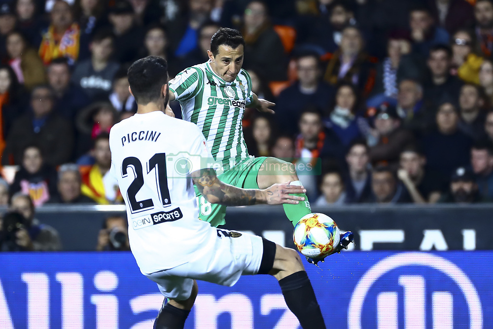 February 28, 2019 - Valencia, Spain - Guardado  of Real Betis Balompi (R) and Piccini of Valencia CF During Spanish King La Copa match between  Valencia cf vs Real Betis Balompie Second leg  at Mestalla Stadium on February 28, 2019. (Photo by Jose Miguel Fernandez/NurPhoto) (Credit Image: © Jose Miguel Fernandez/NurPhoto via ZUMA Press)