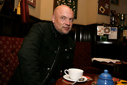 UK ENGLAND LONDON 13DEC11 - Uwe Roesler, trainer of Brentford FC, sits and drinks a cup of white coffee at the Griffin pub on a corner of the Brentford stadium in west London during an interview.......jre/Photo by Jiri Rezac......© Jiri Rezac 2011