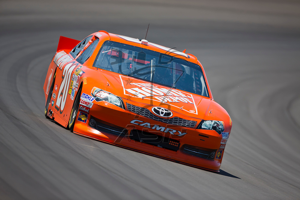 BROOKLYN, MI - JUN 14, 2012:  Joey Logano (20) brings his car through the turns during the second test session for the Quicken Loans 400 at the Michigan International Speedway in Brooklyn, MI.