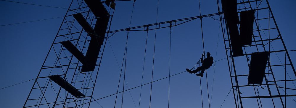 USA, Washington, Protester climbs scaffolding at Ruckus Society camp preparing for Seattle WTO protests