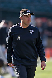 OAKLAND, CA - NOVEMBER 24: Head coach Dennis Allen of the Oakland Raiders watches his team warm up before the game against the Tennessee Titans at O.co Coliseum on November 24, 2013 in Oakland, California. The Tennessee Titans defeated the Oakland Raiders 23-19. (Photo by Jason O. Watson/Getty Images) *** Local Caption *** Dennis Allen