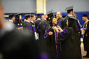 Law students put the finishing touches on their attire before the School of Law Commencement.
