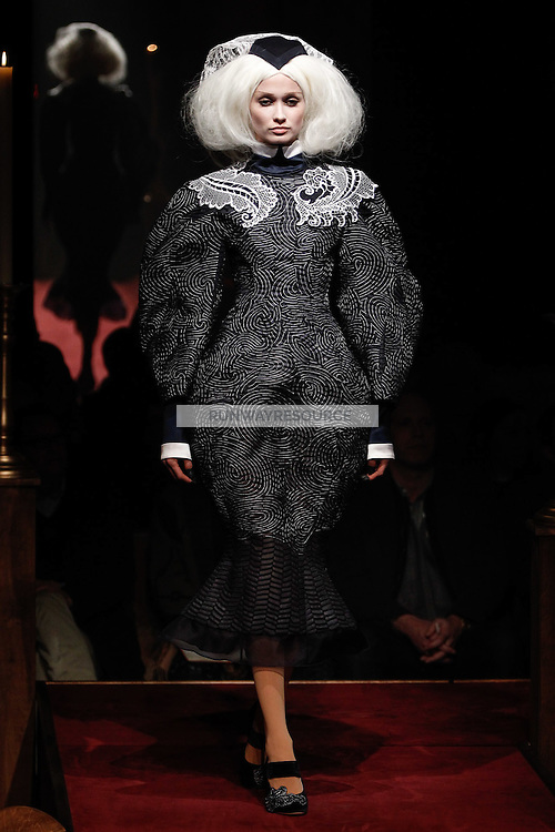 A model walks the runway wearing Thom Browne Fall 2014 Collection, <br /> Thom Browne (Designer)<br /> Jimmy Paul (Hair Stylist)<br /> Sil Bruinsma (Makeup Artist)<br /> Edward Kim (Casting Director)<br /> Julie Kandalec (Manicurist)