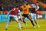 Adam Troare takes on Aaron Cresswell and Pablo Fornals before the Premier League match between Wolverhampton Wanderers and West Ham United at Molineux, Wolverhampton, England on 4 December 2019.