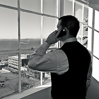 Phone call at office window with a view in Seattle, Creative Commercial Photography by Pettepiece Photography, Tucson Photographer