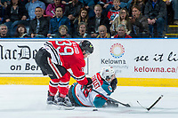 KELOWNA, CANADA - APRIL 14: Colton Veloso #39 of the Portland Winterhawks stick checks Nick Merkley #10 of the Kelowna Rockets tot he ice on April 14, 2017 at Prospera Place in Kelowna, British Columbia, Canada.  (Photo by Marissa Baecker/Shoot the Breeze)  *** Local Caption ***