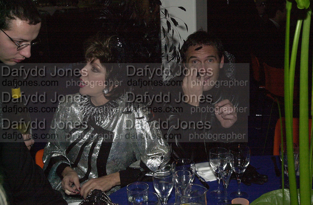 Joan Collins & A.A. Gill.<br />Mr. and Mrs. Andy Wong Chinese Year of the Dragon. Millenium Dome. 29/1/2000.<br />© Copyright Photograph by Dafydd Jones<br />66 Stockwell Park Rd. London SW9 0DA<br />Tel 0171 733 0108. wwwdafjones.com