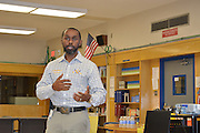 Booker T. Washington Principal Carlos Phillips II introduces the Golden Eagle Rocket teams, who will present the results of their trip to White Sands Missile Range in New Mexico.
