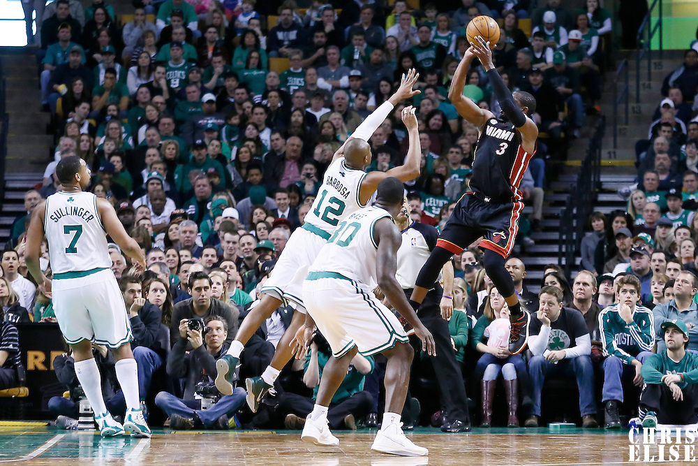 27 January 2013: Miami Heat shooting guard Dwyane Wade (3) takes a jumpshot over Boston Celtics shooting guard Leandro Barbosa (12) during the Boston Celtics 100-98  2OT victory over the Miami Heat at the TD Garden, Boston, Massachusetts, USA.