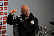 Cardiff city assistant manager Mark Dempsey speaks to the media at the Cardiff city fc press conference at the Vale resort hotel in Hensol, near Cardiff, South Wales on Friday 28th March 2014. the pc is a pre Barclays premier league looking ahead to West Brom match tomorrow.<br /> pic by Andrew Orchard, Andrew Orchard sports photography.