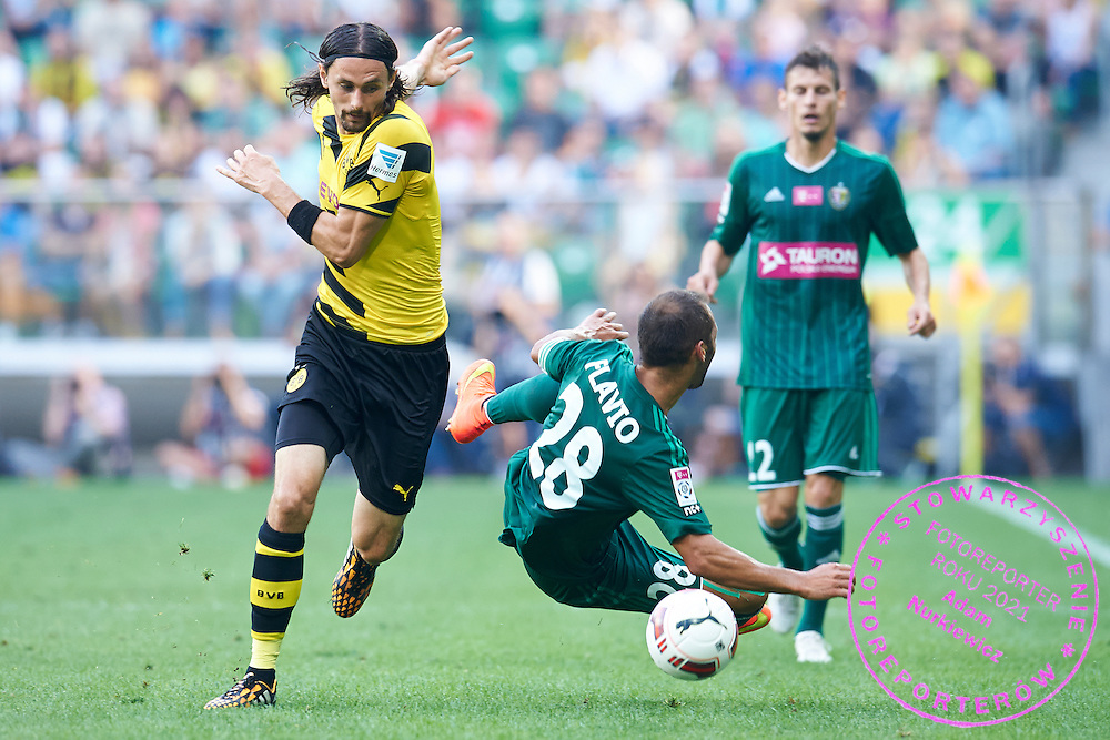(L) Neven Subotic of Dorussia Dortmund fights for the ball with (R) Flavio Paixao of Slask Wroclaw during international friendly soccer match between WKS Slask Wroclaw and BVB Borussia Dortmund on Municipal Stadium in Wroclaw, Poland.<br /> <br /> Poland, Wroclaw, August 6, 2014<br /> <br /> Picture also available in RAW (NEF) or TIFF format on special request.<br /> <br /> For editorial use only. Any commercial or promotional use requires permission.<br /> <br /> Mandatory credit:<br /> Photo by &copy; Adam Nurkiewicz / Mediasport