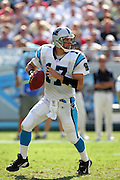 CHARLOTTE, NC - SEPTEMBER 18:  Quarterback Jake Delhomme #12 of the Carolina Panthers looks for a receiver against the New England Patriots at Bank of America Stadium on September 18, 2005 in Charlotte, North Carolina. The Panthers defeated the Patriots 27-17. ©Paul Anthony Spinelli *** Local Caption *** Jake Delhomme