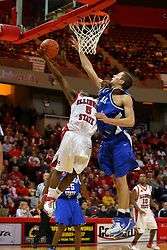 "06 January 2007: Keith ""Boo"" Richardson lays one up with Cole Holmstrom trying to block.  The Sycamores of Indiana State University topped the Redbirds home 54 - 50 inside Redbird Arena in Normal Illinois on the campus of Illinois State University.<br />"