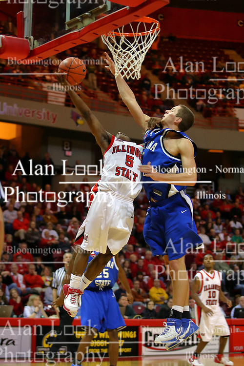 """06 January 2007: Keith """"Boo"""" Richardson lays one up with Cole Holmstrom trying to block.  The Sycamores of Indiana State University topped the Redbirds home 54 - 50 inside Redbird Arena in Normal Illinois on the campus of Illinois State University.<br />"""