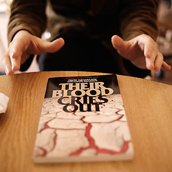 "Troy Newman's book ""Their blood cries out"", as shown by a pro-choice militant in Wichita, KS. 2009, June 19th. Photo: Antoine Doyen"