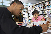 Students studying in college library