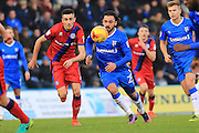 Matty Lund chases Bradley Dack  during the EFL Sky Bet League 1 match between Gillingham and Rochdale at the MEMS Priestfield Stadium, Gillingham, England on 26 November 2016. Photo by Daniel Youngs.