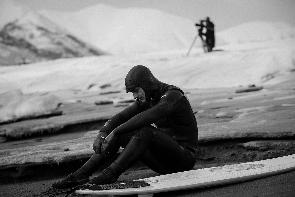 The look of defeat. Or is that hypothermia. Mark Landvik catches his breathe after a not so fun morning surf.