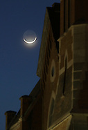 Middletown, New York - The waxing crescent moon shines next to two churches on the evening of Feb. 23, 2012.