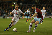 Milton Keynes Dons forward Dean Bowditch takes on Burnley defender Michael Keane during the Sky Bet Championship match between Burnley and Milton Keynes Dons at Turf Moor, Burnley, England on 15 September 2015. Photo by Simon Davies.