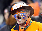 A Denver Broncos fan in team gear yells out in apparent anger after an official's call during the Denver Broncos 2015 NFL week 16 regular season football game against the Cincinnati Bengals on Monday, Dec. 28, 2015 in Denver. The Broncos won the game in overtime 20-17. (©Paul Anthony Spinelli)