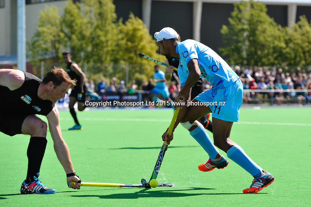 Mandeep Singh of India is tackled by Brad SHAW of the Black Sticks during the Mens Hockey International, 2015 South Island Tour game between the New Zealand Black Sticks V India, at Marist Park, Christchurch, on the 11th October 2015. Copyright Photo: John Davidson / www.photosport.nz
