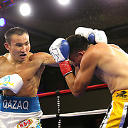 """Kanat """"QazaQ"""" Islam of Almaty, Kazakhstan (L) punches Noroberto """"Demonio"""" Gonzalez of Monterrey, Mexico to win the NABO Jr. Middle Weight Title during a Nelsons Promotions boxing match at the Boca Raton Resort  and Club on Friday, May 26, 2017 in Boca Raton, Florida.  (Alex Menendez via AP)"""