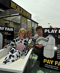 © Licensed to London News Pictures. 11/08/2012 Cannock Staffordshire.[front middle rear] Charlotte Bower, May Kite and Protest organiser Matthew Weaver, are all Dairy Farmers,they  are part of a wider protest across the UK today .The peaceful protest, lying  in a bath of milk! Is being held outside Morrisons Supermarket by the  milk producers who believe they're not being paid a fair price for milk the industry produces by  some supermarkets..Photo credit : Rob Leyland/LNP© Licensed to London News Pictures. 11/08/2012 Cannock Staffordshire.[front middle rear] Charlotte Bower, May Kite and Protest organiser Matthew Kettering, are all Dairy Farmers,they  are part of a wider protest across the UK today .The peaceful protest, lying  in a bath of milk! Is being held outside Morrisons Supermarket by the  milk producers who believe they're not being paid a fair price for milk by some supermarkets..Photo credit : Rob Leyland/LNP