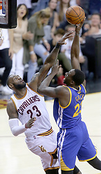 The Cleveland Cavaliers' LeBron James, left, defends a shot inside by the Golden State Warriors' Draymond Green during Game 4 of the NBA Finals at Quicken Loans Arena in Cleveland on Friday, June 9, 2017. The Cavs won, 137-116, trimming their series deficit to 3-1. (Photo by Phil Masturzo/Akron Beacon Journal/TNS) *** Please Use Credit from Credit Field ***