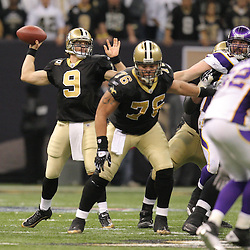 Jan 24, 2010; New Orleans, LA, USA; New Orleans Saints quarterback Drew Brees (9) looks to pass the ball during a 31-28 overtime victory by the New Orleans Saints over the Minnesota Vikings in the 2010 NFC Championship game at the Louisiana Superdome. Mandatory Credit: Derick E. Hingle-US PRESSWIRE