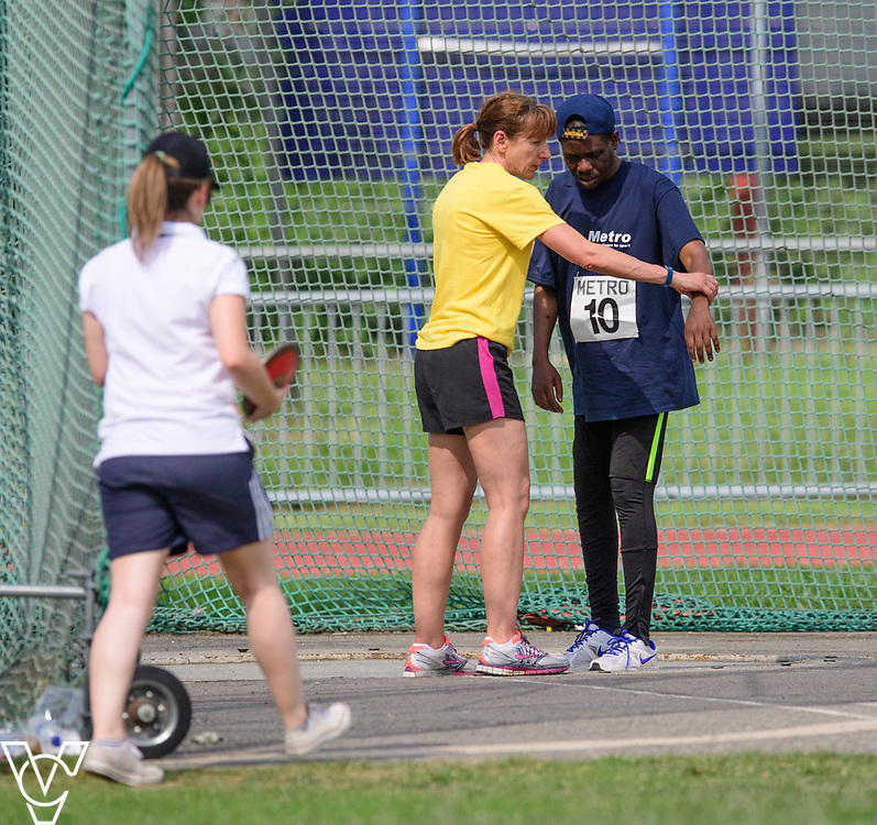 Metro Blind Sport's 2017 Athletics Open held at Mile End Stadium.  Discus.  William Safo with volunteer<br /> <br /> Picture: Chris Vaughan Photography for Metro Blind Sport<br /> Date: June 17, 2017