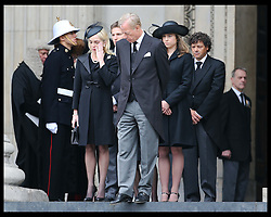 Sir Mark Thatcher's wife Sarah wipes away a tear as they watch  Baroness Thatcher's  coffin leaving  St.Paul's Cathedral in London , Wednesday 17th  April 2013 Photo by: Stephen Lock / i-Images