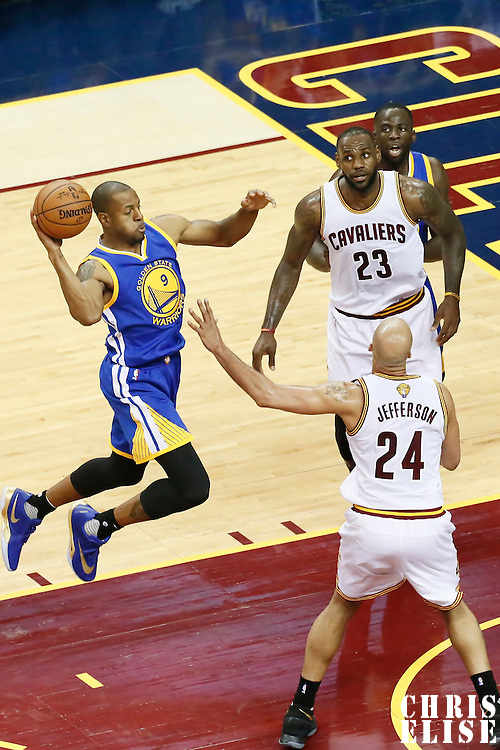 10 June 2016: Golden State Warriors forward Andre Iguodala (9) passes the ball over Cleveland Cavaliers forward Richard Jefferson (24) next to Cleveland Cavaliers forward LeBron James (23) and Golden State Warriors forward Draymond Green (23) during the Golden State Warriors 108-97 victory over the Cleveland Cavaliers, during Game Four of the 2016 NBA Finals at the Quicken Loans Arena, Cleveland, Ohio, USA.