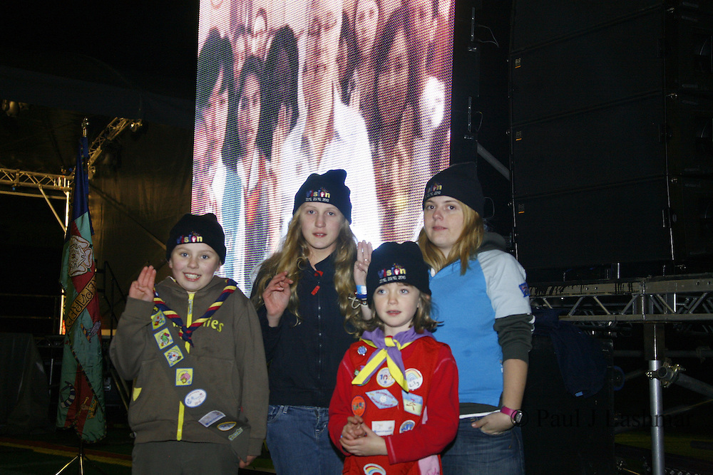 l-r brownie, Rosie McKenna, Guide, Millie Beardsworth, Rainbow, Lily Tierney, Senior Section member, Alice Upright renew the promise with Chief Guide Liz Burnley (onscreen)