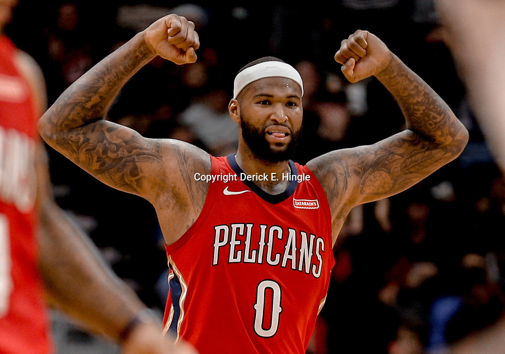Dec 13, 2017; New Orleans, LA, USA; New Orleans Pelicans center DeMarcus Cousins (0) reacts after a score by teammate guard E'Twaun Moore (not pictured) during the fourth quarter against the Milwaukee Bucks at the Smoothie King Center. The Pelicans defeated the Bucks 115-108. Mandatory Credit: Derick E. Hingle-USA TODAY Sports