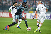Warsaw, Poland - 2017 February 16: (C) Bertrand Traore of Ajax Amsterdam fights for the ball during soccer match Legia Warszawa v Ajax Amsterdam - UEFA Europe League  at Municipal Stadium on February 16, 2017 in Warsaw, Poland.<br /> <br /> Mandatory credit:<br /> Photo by &copy; Adam Nurkiewicz / Mediasport<br /> <br /> Adam Nurkiewicz declares that he has no rights to the image of people at the photographs of his authorship.<br /> <br /> Picture also available in RAW (NEF) or TIFF format on special request.<br /> <br /> Any editorial, commercial or promotional use requires written permission from the author of image.