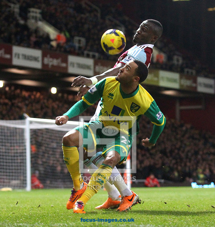 Picture by Paul Chesterton/Focus Images Ltd +44 7904 640267<br /> 11/02/2014<br /> Nathan Redmond of Norwich and Mohamed Diame of West Ham in action during the Barclays Premier League match at the Boleyn Ground, London