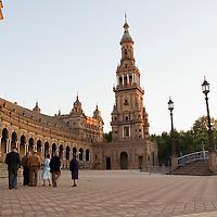 A group of senior Sevillanos taking a late afternoon stroll in the Plaza de España, Sevilla, Andalucia, Spain.